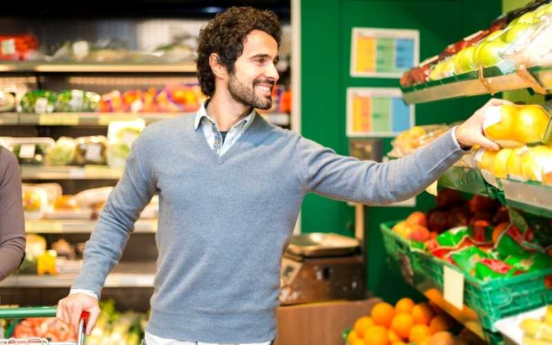 Man Picking Fresh Produce at Grocery Store
